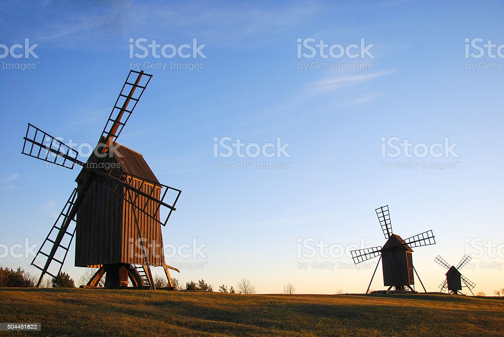 Old wooden windmills stock photo