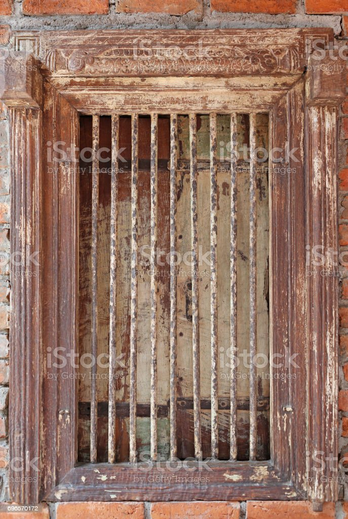 Old wooden window grilles on brick wall. stock photo