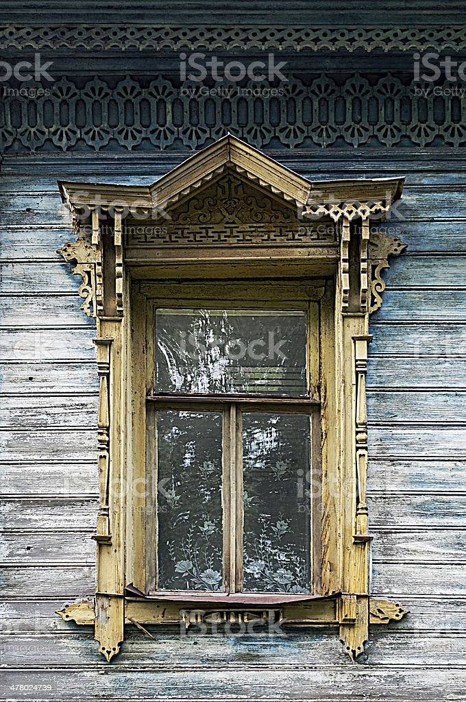 Old wooden window with carved platbands royalty-free stock photo