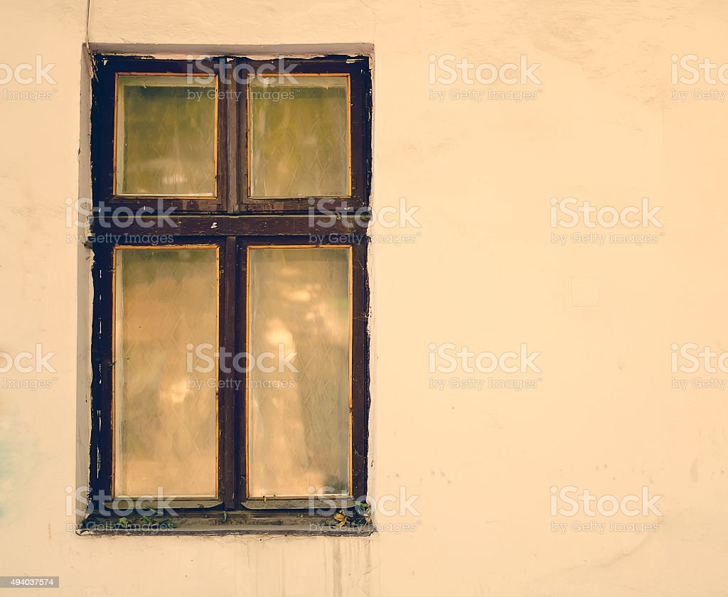Old wooden windows frame on cement cracked wall stock photo