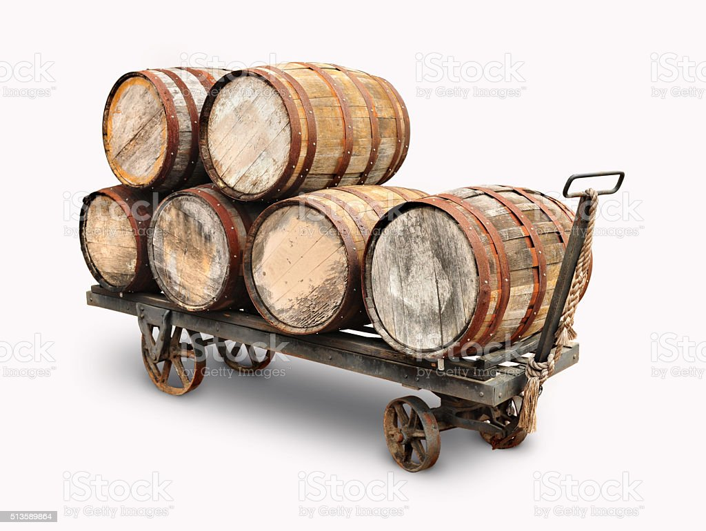 Old wooden wine barrels piled on a cart stock photo