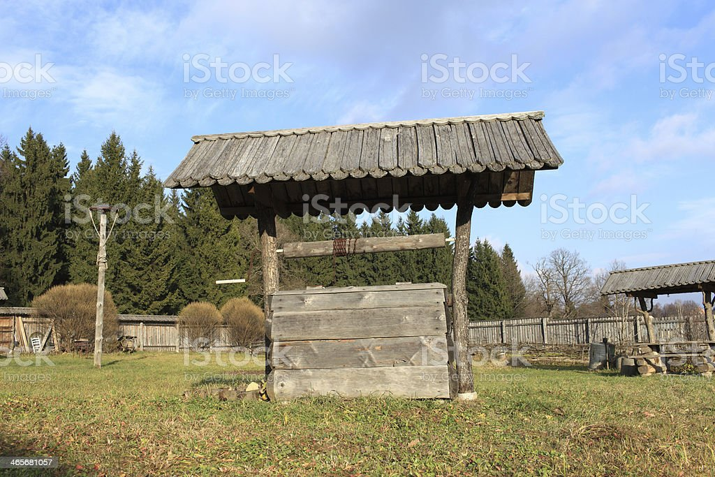 Old wooden wishing well stock photo
