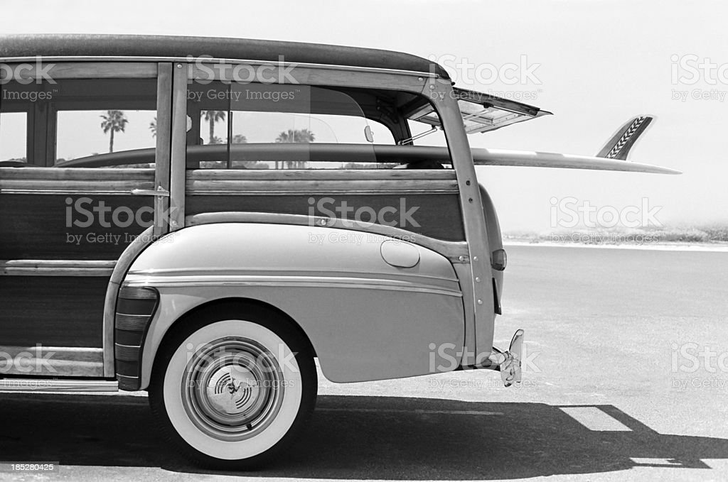 Old Woodie Station Wagon with Surfboard stock photo