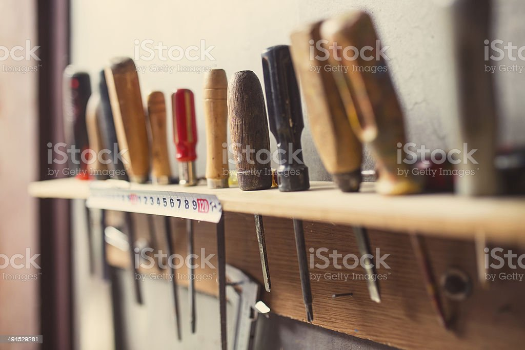 Old woodworking tools on wall, retro tinted stock photo