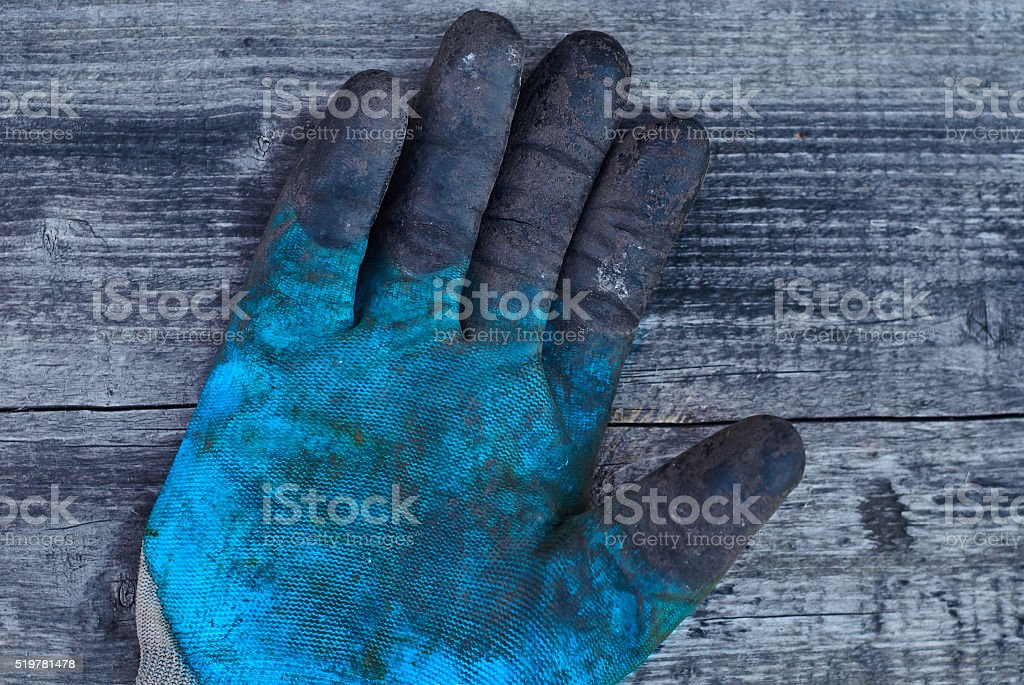 Old work glove, rubber glove, professional hand protection, dirty glove stock photo