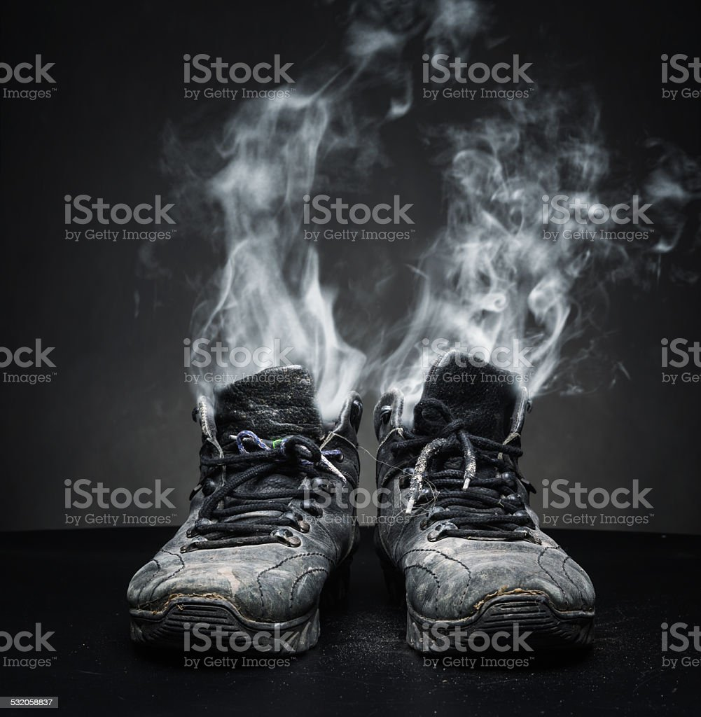 Old work shoes in smoke stock photo