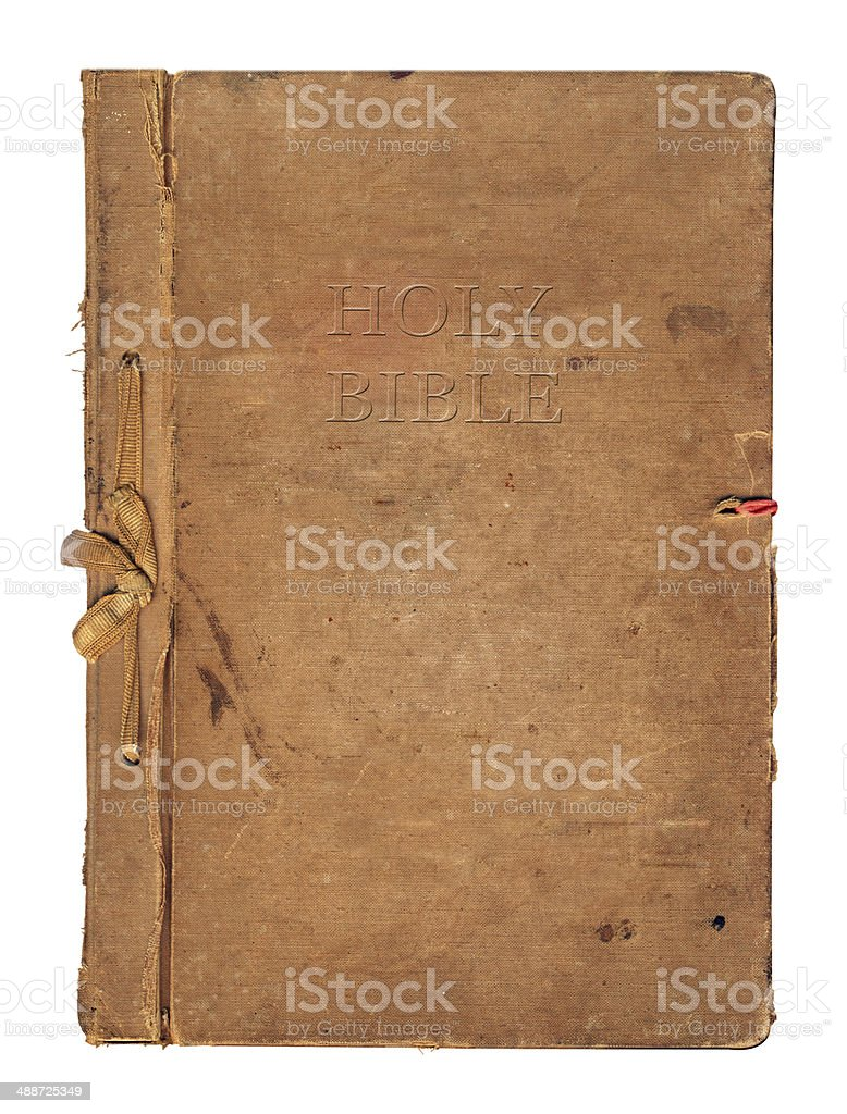 Old worn book cover with ribbon and bow stock photo