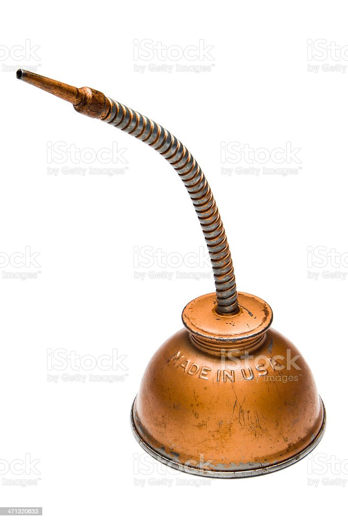 Old worn copper oil dispenser with flexible neck on white royalty-free stock photo