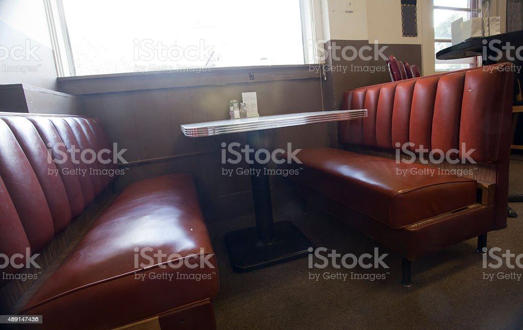 Old Worn Diner Booth stock photo