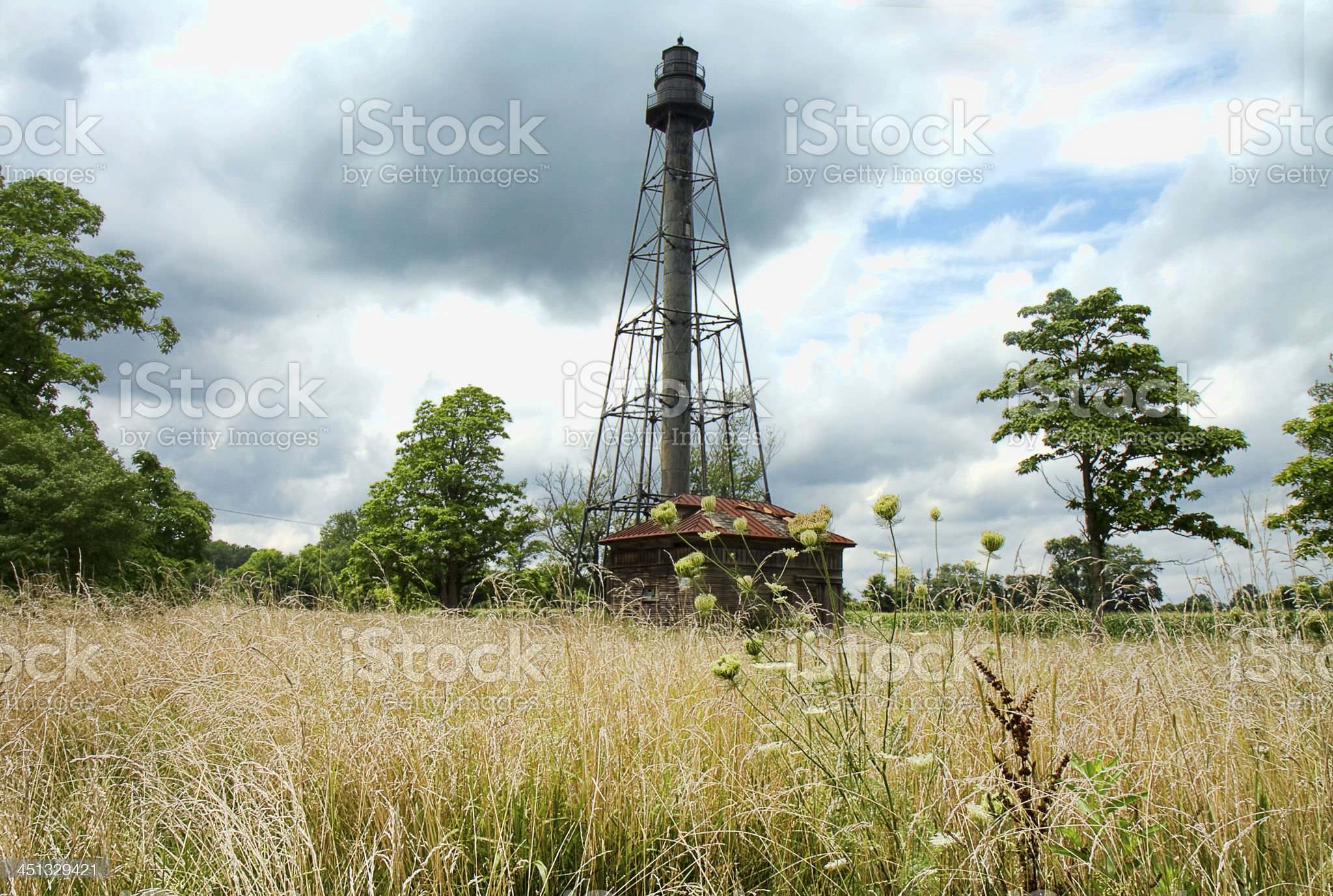 Old Worn Lighthouse in Field royalty-free stock photo