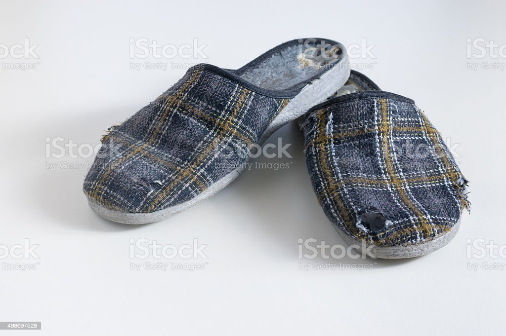 Old worn Low-heeled slippers stock photo
