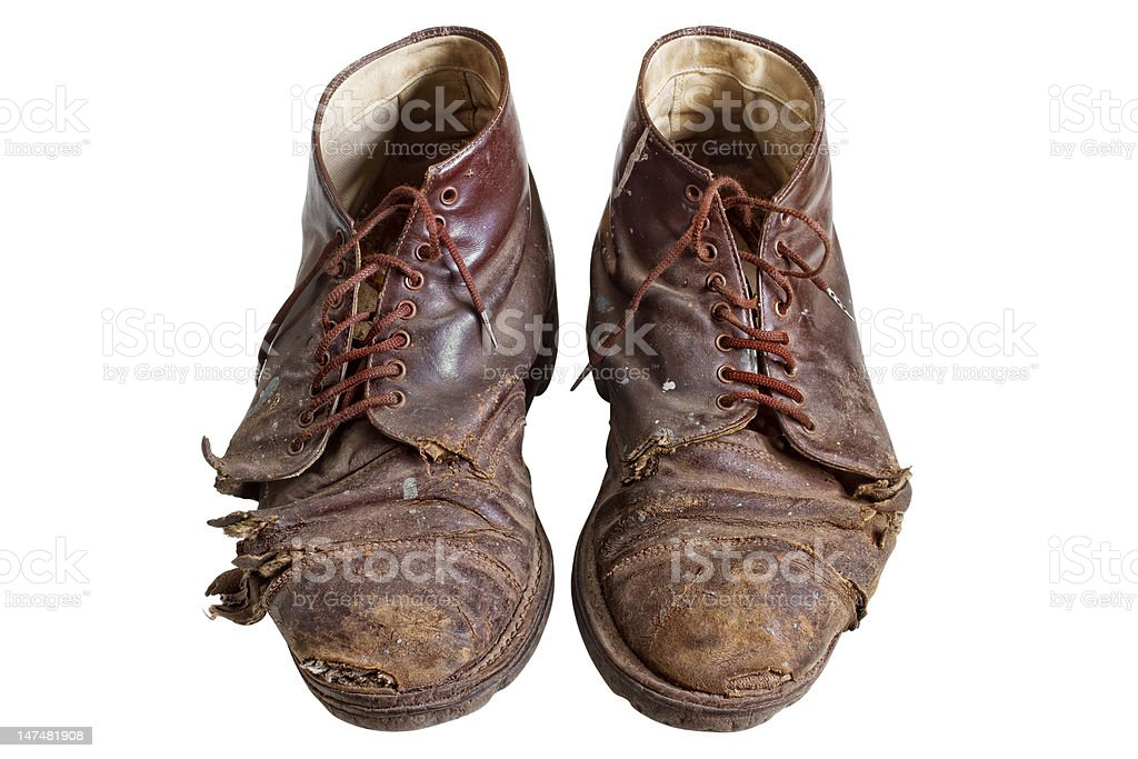 Old worn out boots stock photo