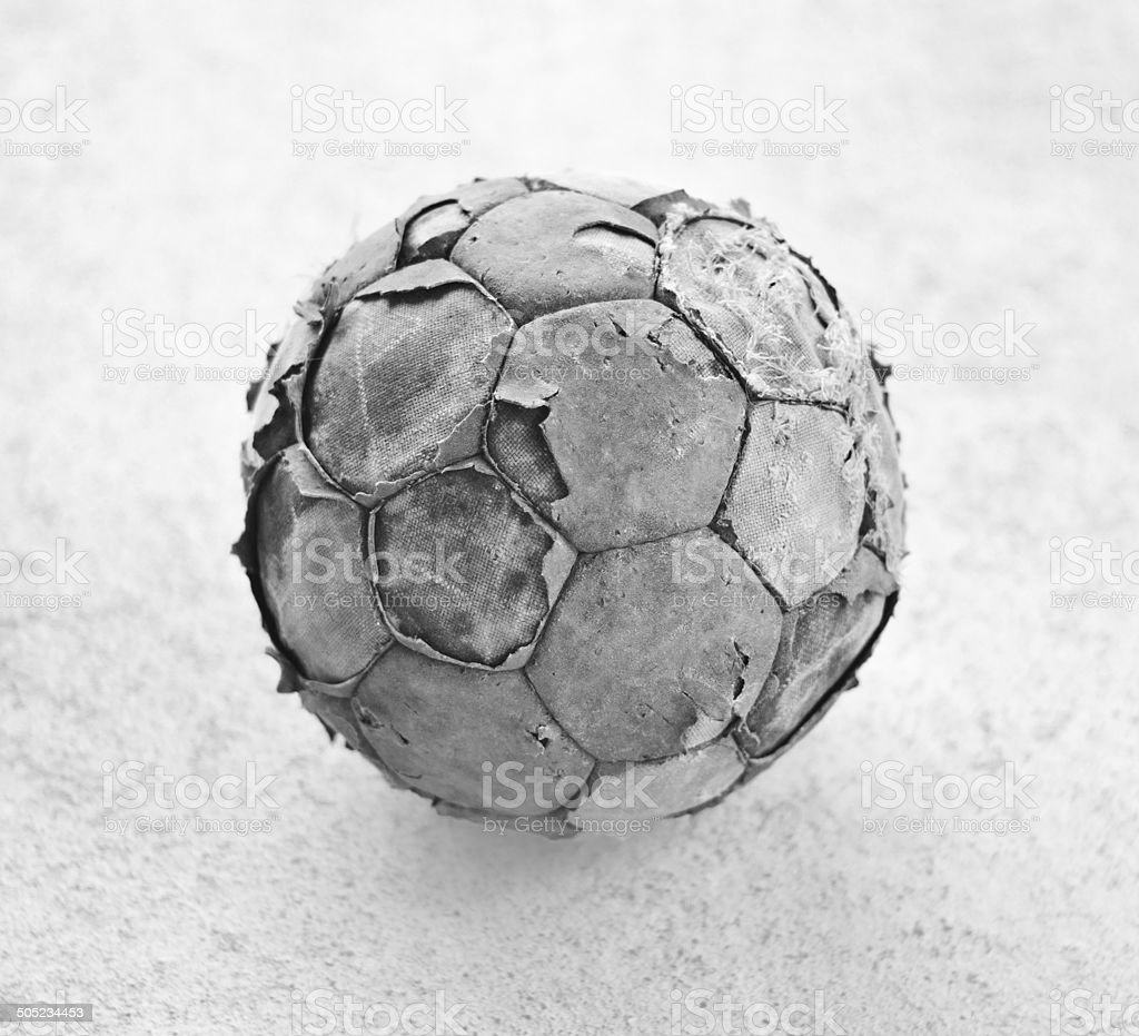 Old worn soccer ball in black and white royalty-free stock photo