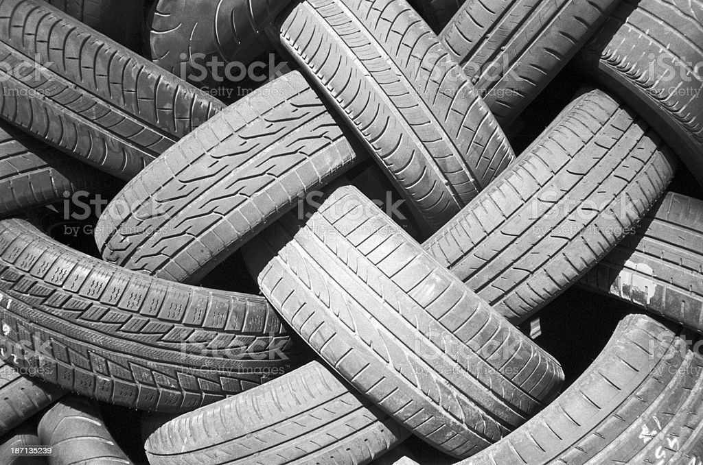 Old worn tires for cars, stacked stock photo