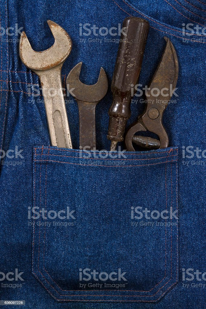 Old Wrench Set in a Blue Jean Pocket stock photo