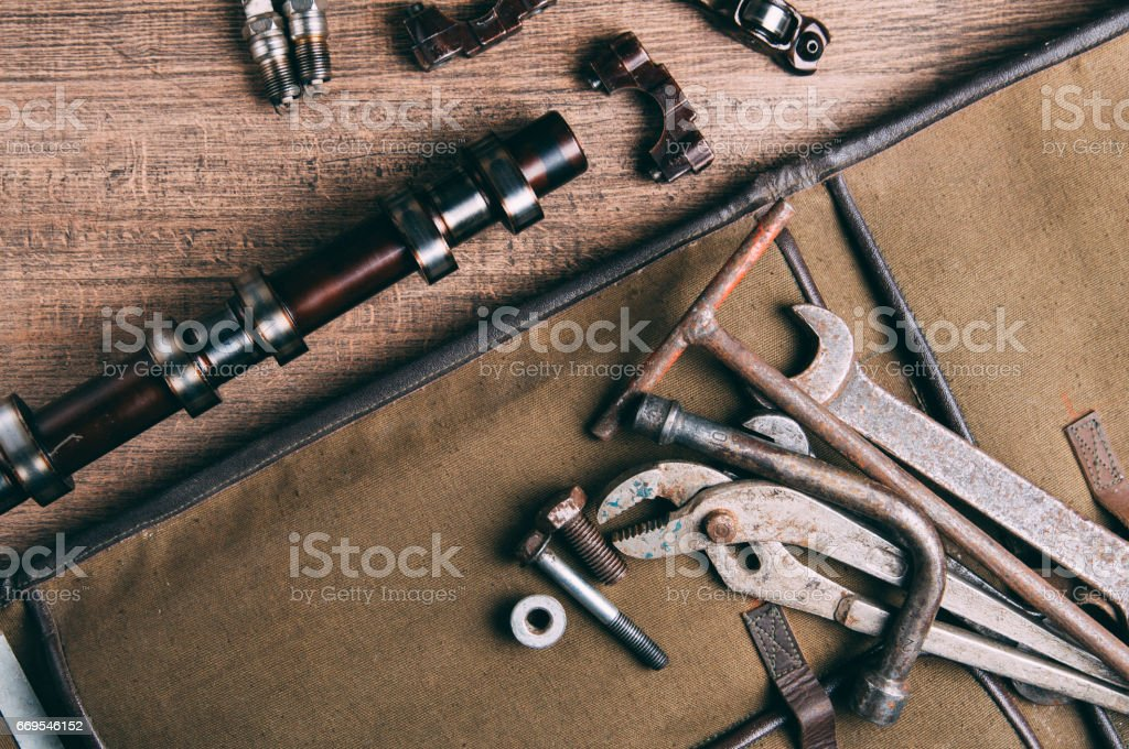 Old wrenches and auto parts. The concept of the garage stock photo