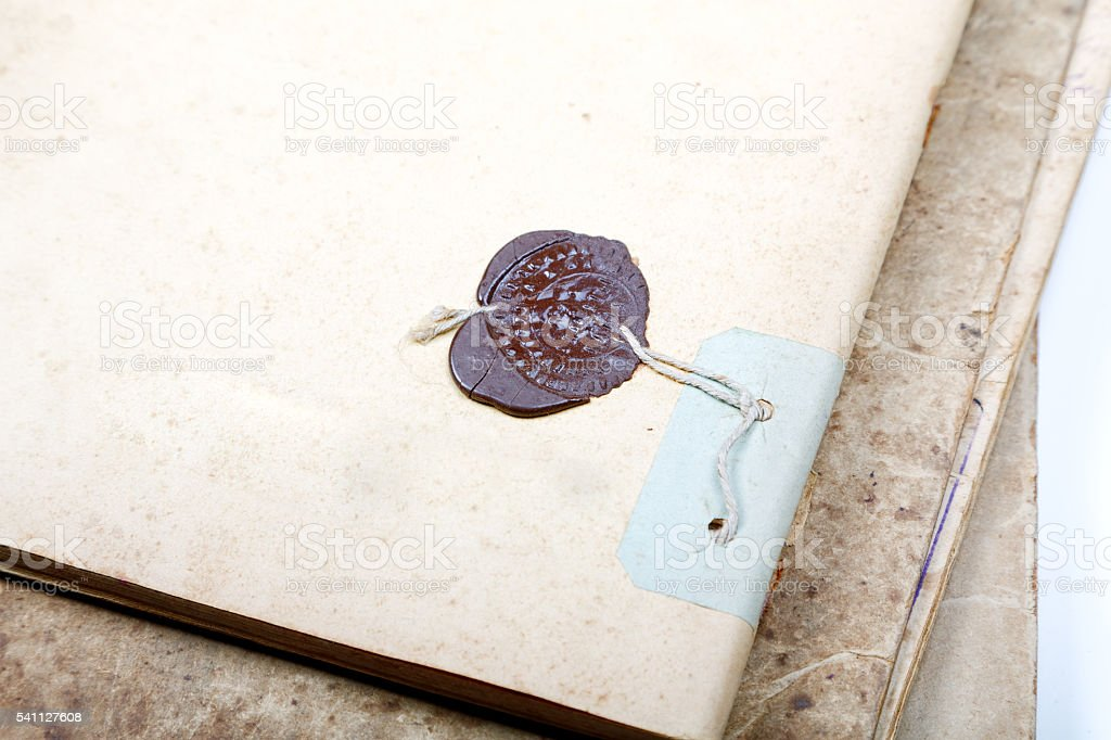 Old writing-book with the sealing wax press stock photo