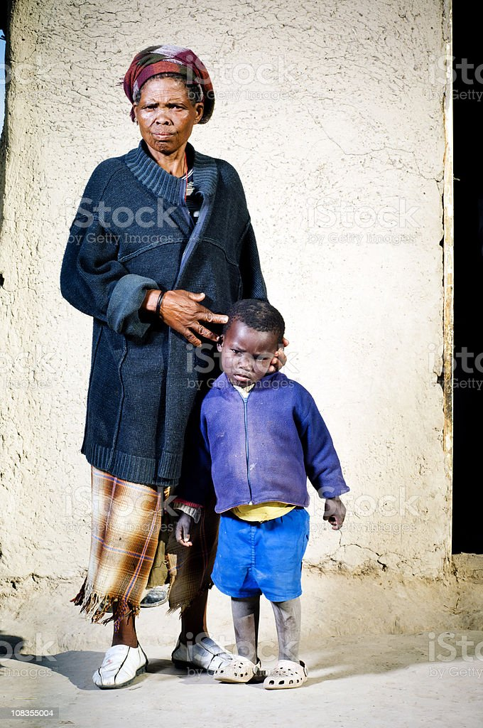 Old Xhosa woman with grandchild royalty-free stock photo