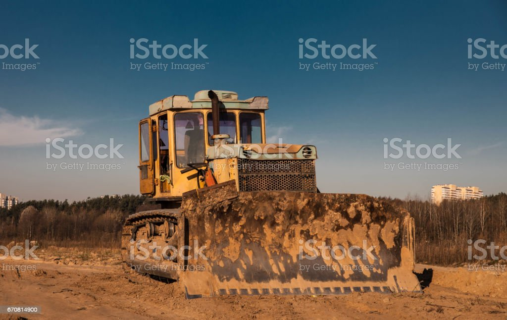 Old yellow bulldozer stock photo