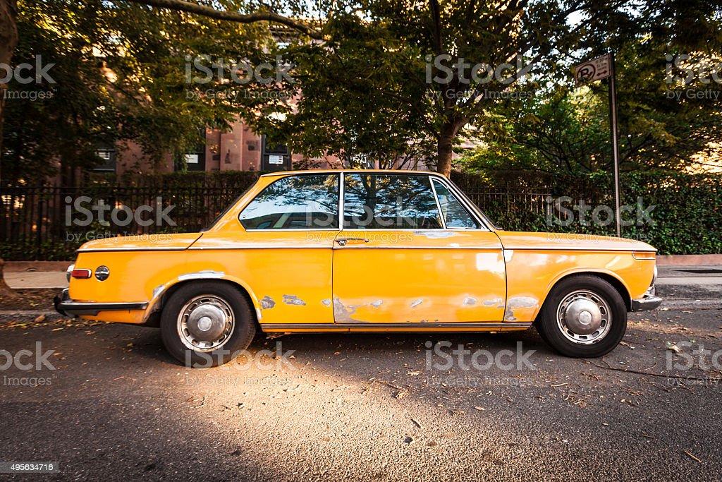 Old Yellow Car in Brooklyn stock photo