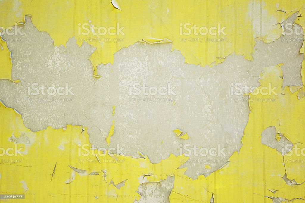 Old yellow cracked on the concrete wall. stock photo