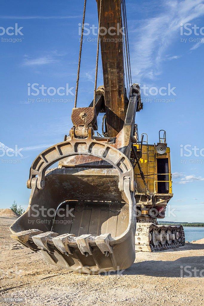 Old yellow excavator stock photo
