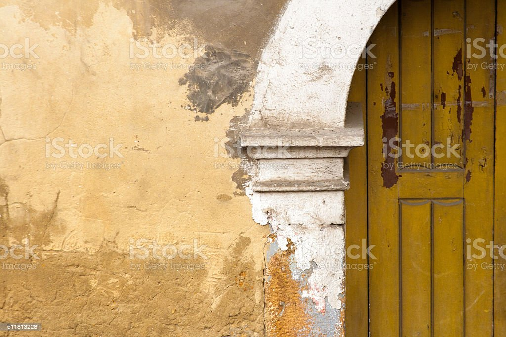 Old Yellow Sicilian Door, Mottled Yellow Wall (Close-Up) stock photo