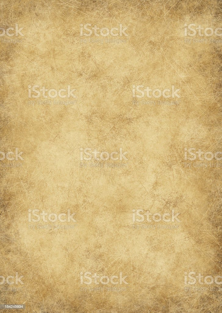 Old yellow stained parchment paper stock photo