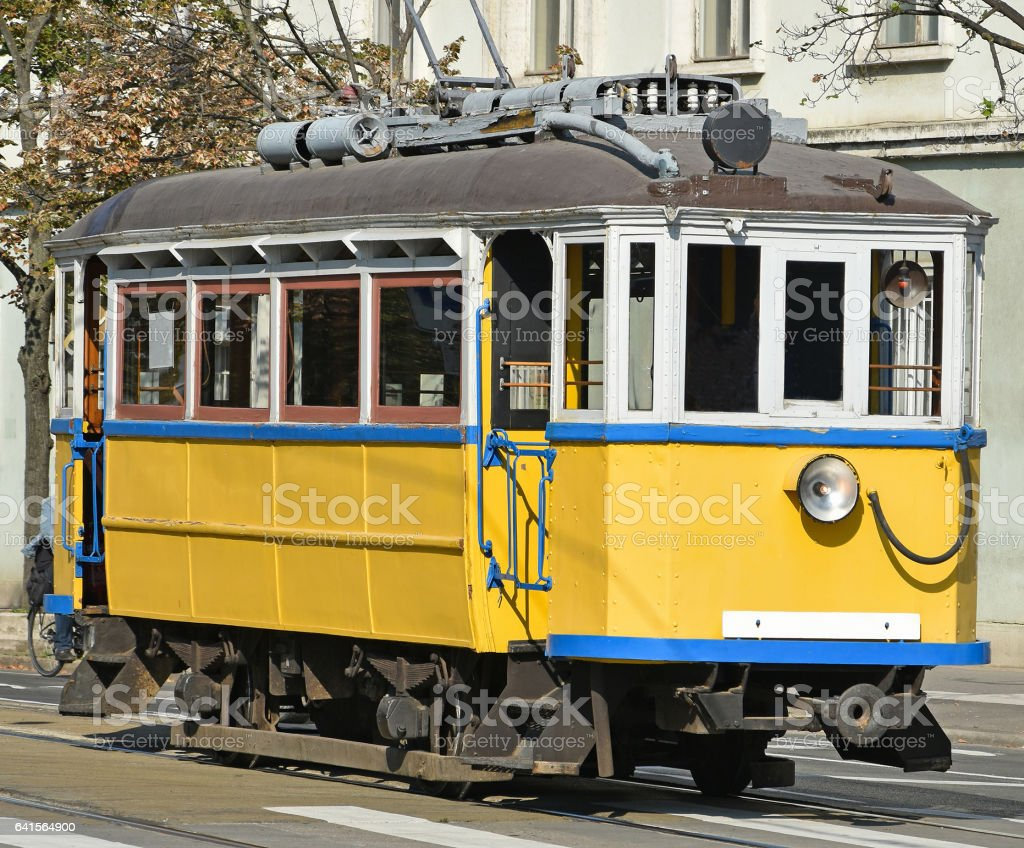 Old yellow tram in the city stock photo