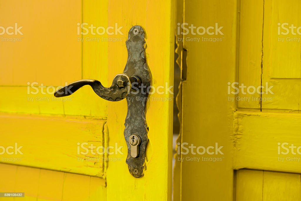 Old yellow wooden antique door opening stock photo