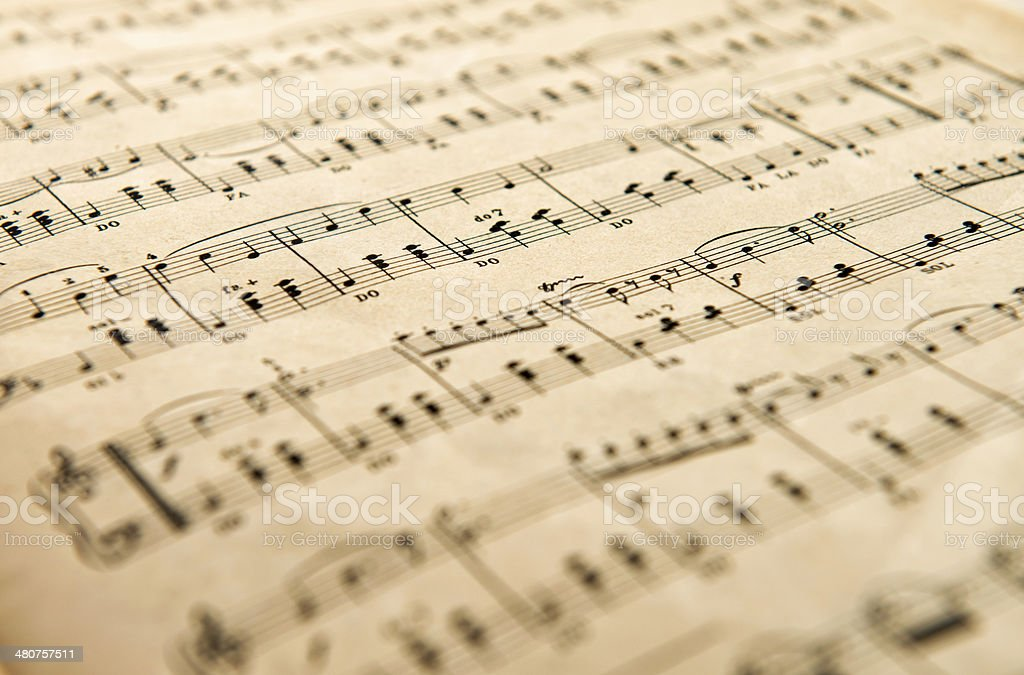Old yellowed aged music score stock photo