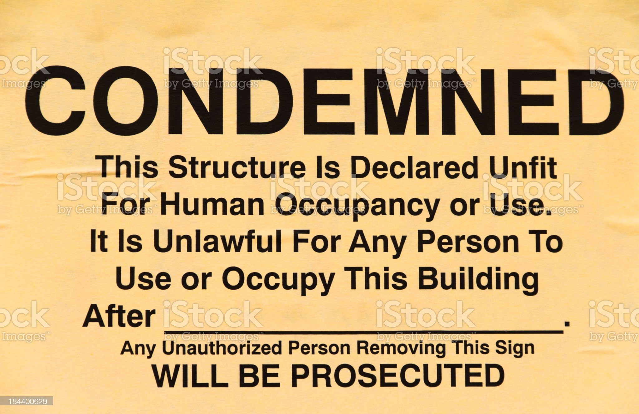 Old Yellowed Comdemned Building Sign royalty-free stock photo