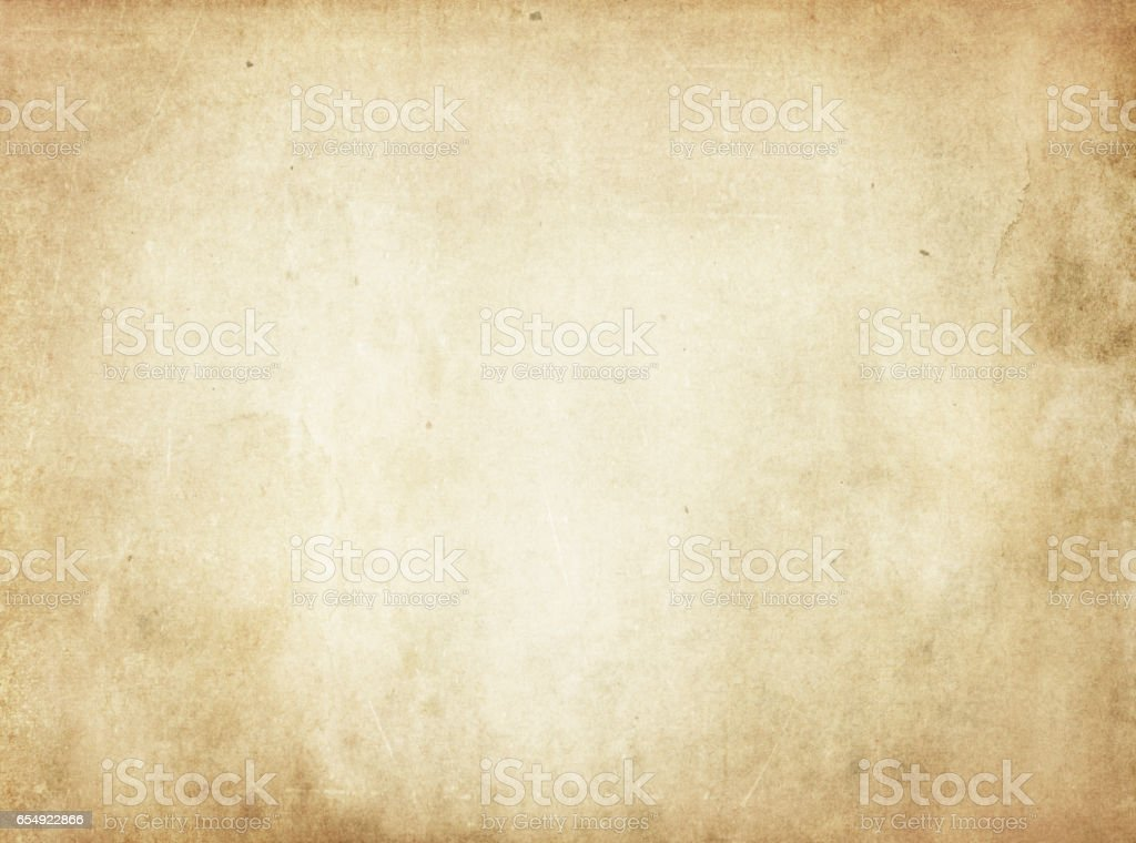 Old yellowed stained paper texture. stock photo