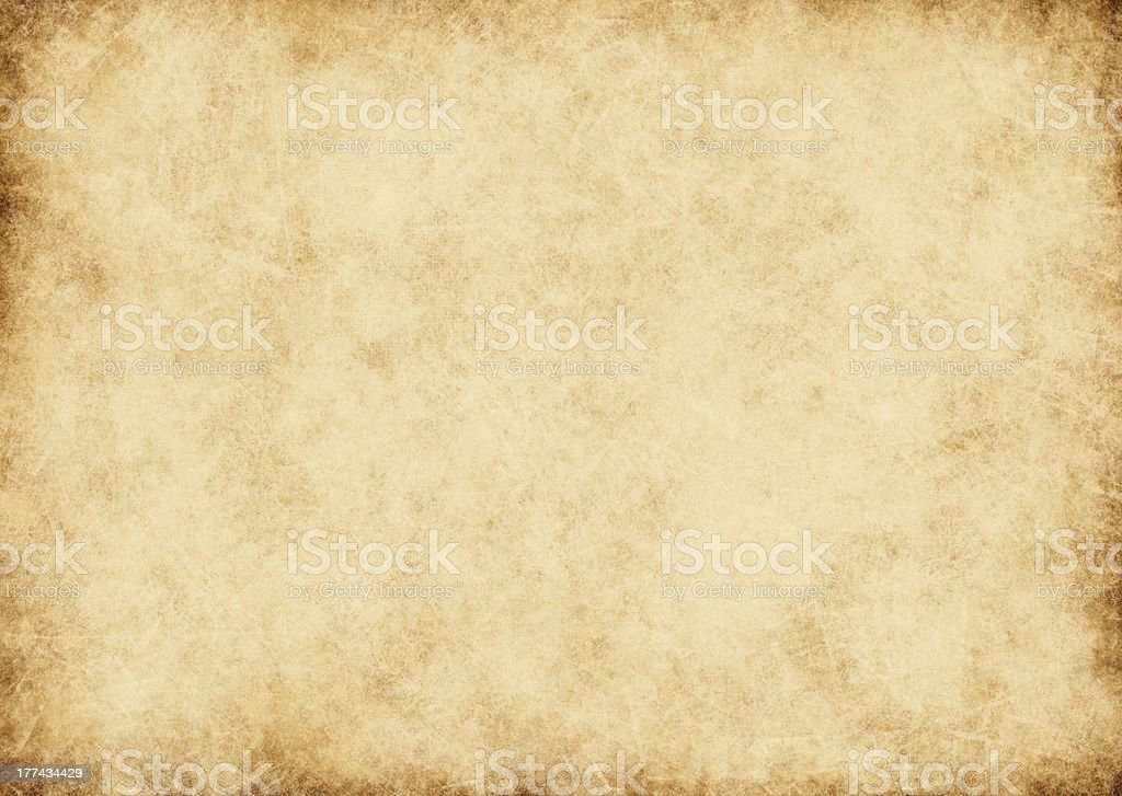 Old yellowed vintage parchment paper stock photo