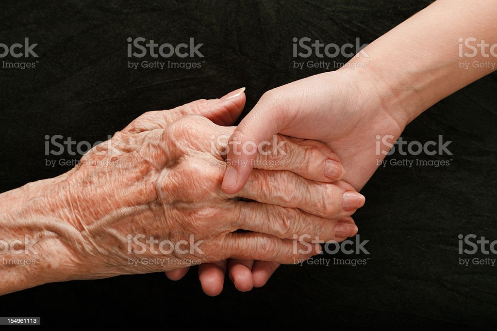 old young hands reaching and holding royalty-free stock photo