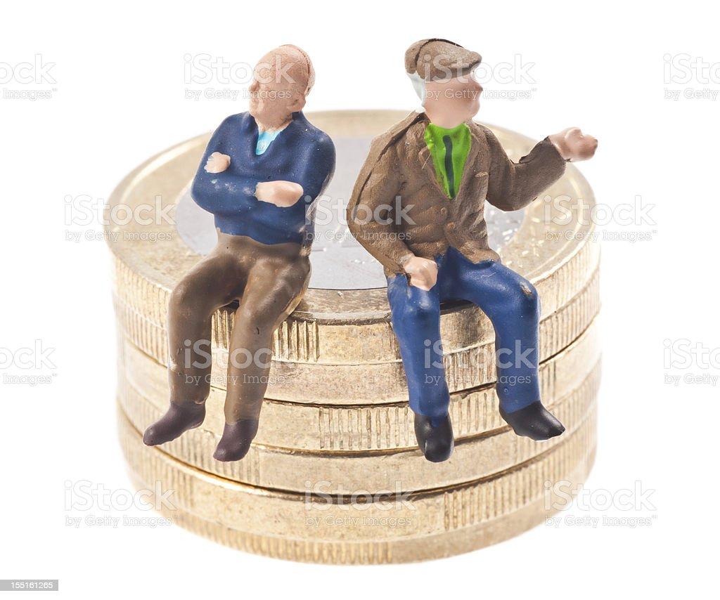 old-age pension - Rentner auf Euromünzen stock photo