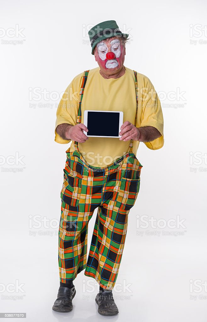 Old-aged Clown with iPad stock photo