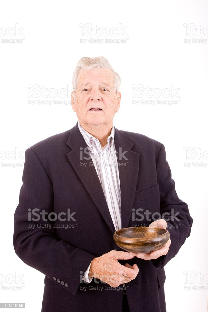 Older Caucasian Man Holding Wooden Bowl, Isolated on White Background royalty-free stock photo