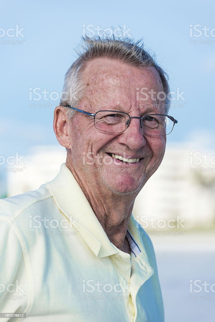 Older Caucasian man smiling and looking at the camera royalty-free stock photo