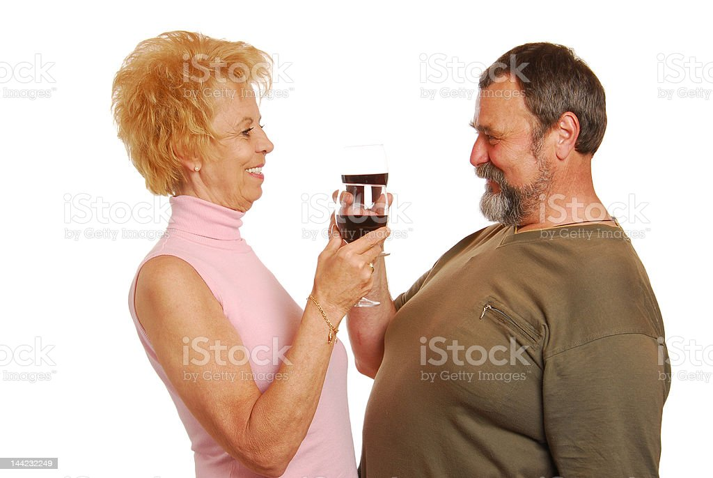 Older couple happy drinking a red wine royalty-free stock photo