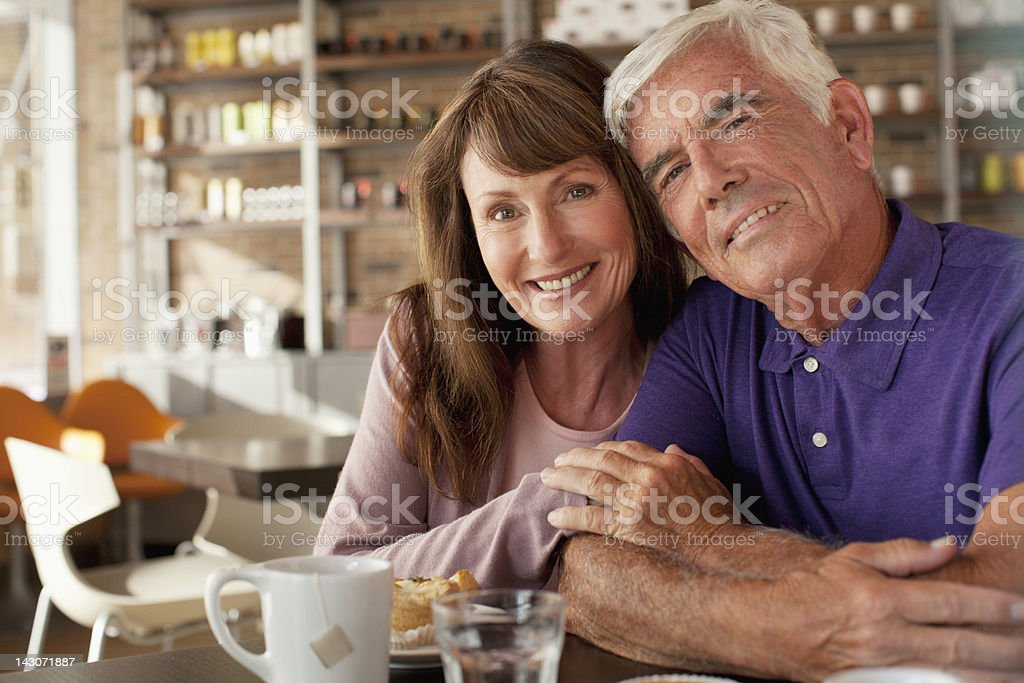 Older couple having breakfast in cafe royalty-free stock photo