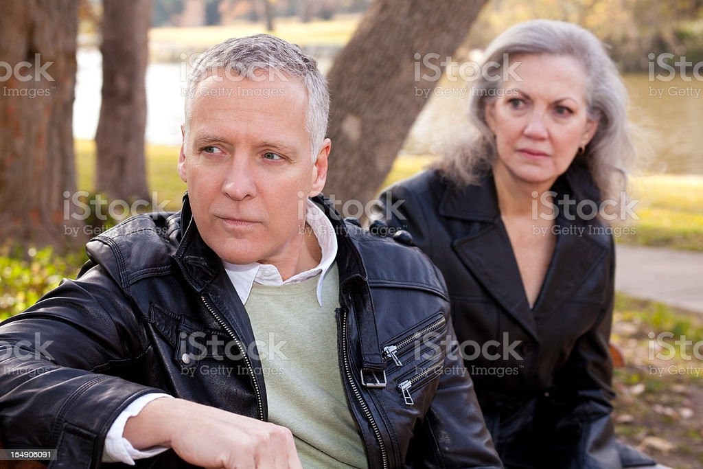 Older couple sitting together outside royalty-free stock photo