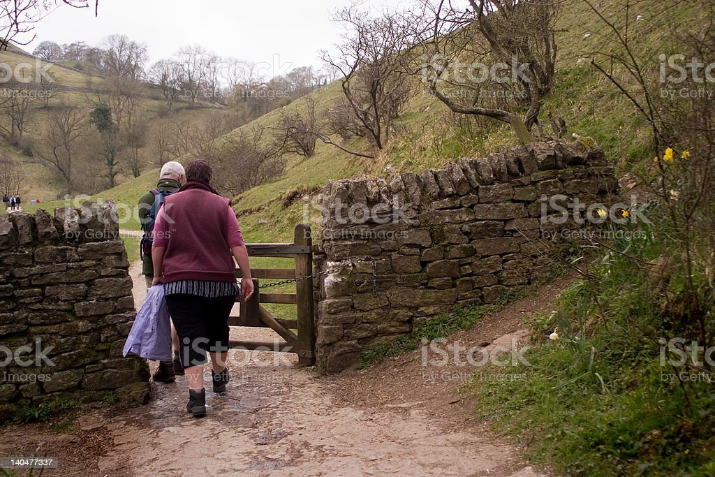 older couple walking in countryside stock photo