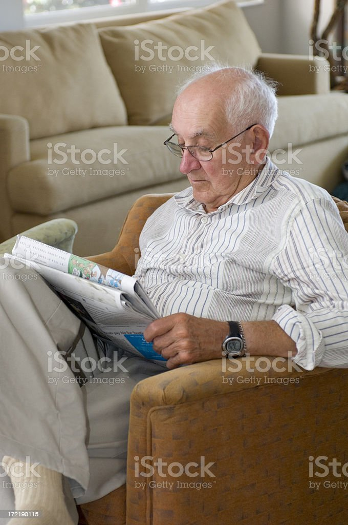 Older Gentleman Reading the Paper stock photo