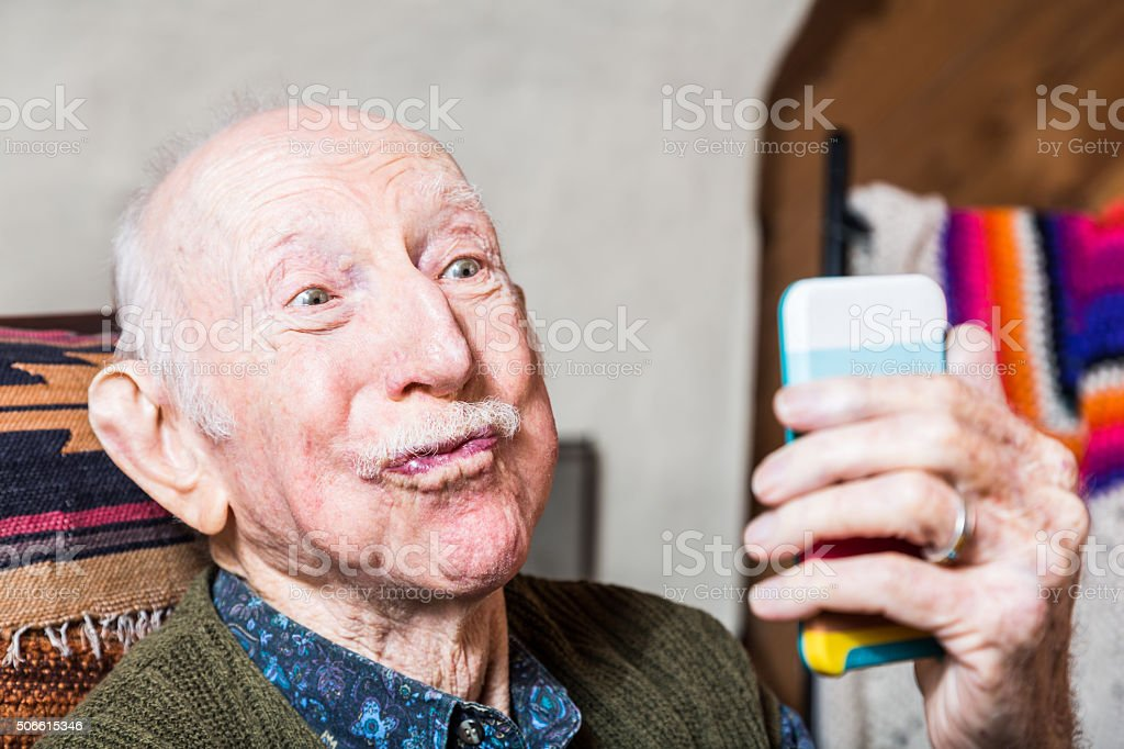 Older Gentleman with Smartphone stock photo