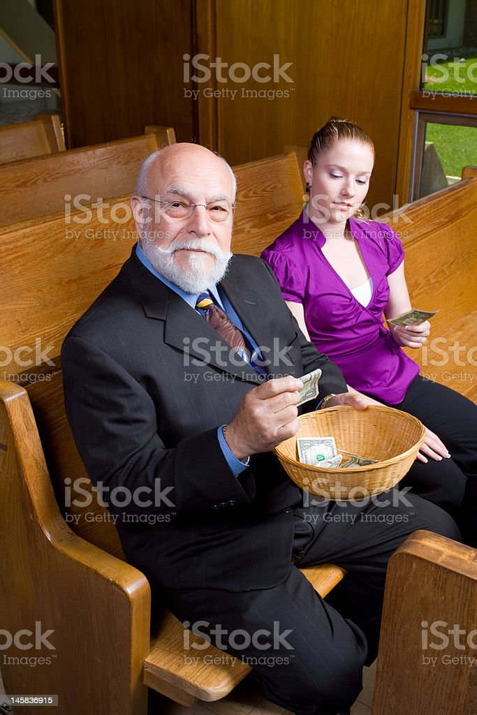 Older Man and Young Woman with Church Offering Basket stock photo