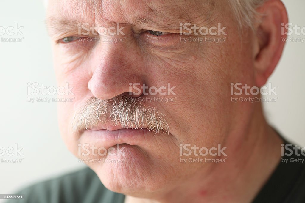 Older man has stomach distress stock photo