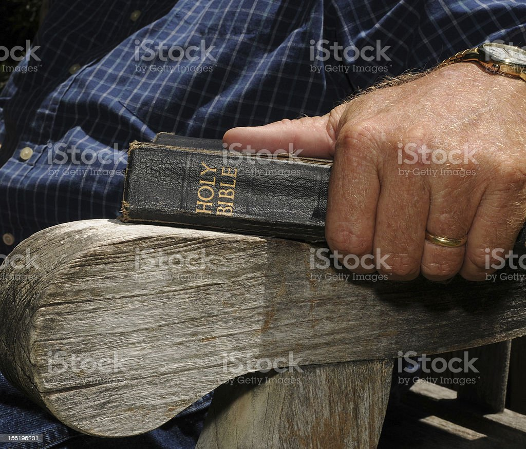 Older man holding a Bible stock photo
