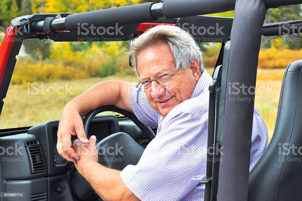 Older Man in an Off Road Vehicle stock photo
