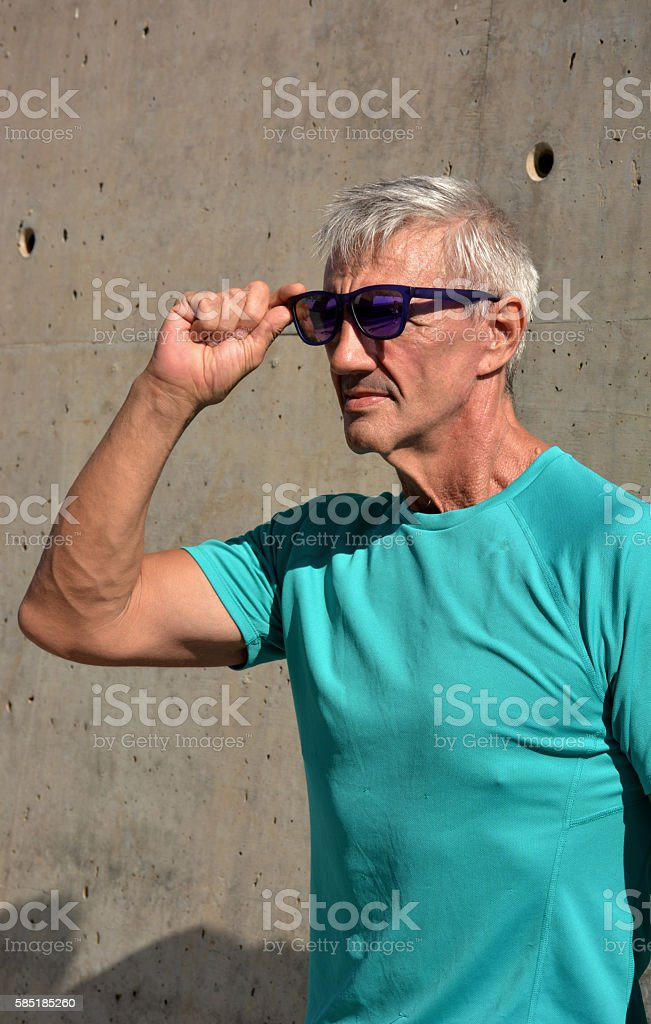 Older man practicing stretching stock photo